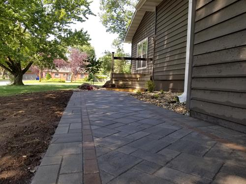 Paver walkway with custom pattern and inlay feature