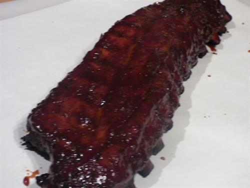 Baby Back Ribs Prepared With Mitch Maier's Black Garlic BBQ Sauce