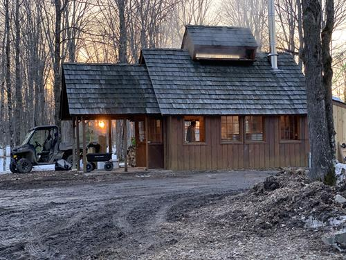 Sugar shack during maple syrup season. Evaporator is fired up inside.