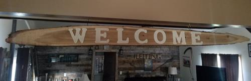 """70"""" cedar welcome sign currently available $50"""