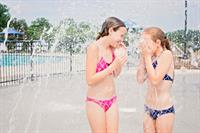 Sisters sharing sweet giggles & fun at the Millstone Town Center splash pad in Hendersonville, TN