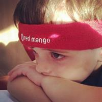 Gallery Image child_with_red_mango_headband.jpg
