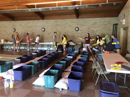 LT Social Action Project student volunteers help with shelter cleanup