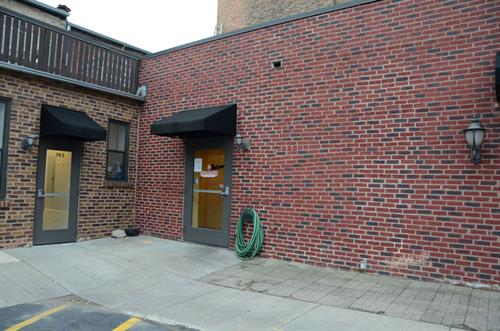 Rear Entrance, Located in the Southeast Corner of the Horton's Ace Parking Lot