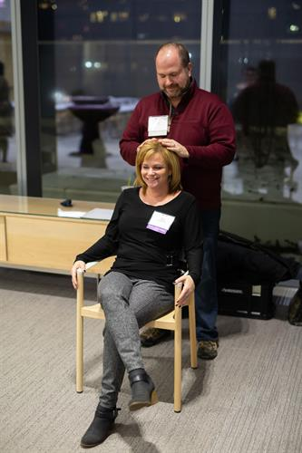 What it looks like giving Reiki to an attendee during an ILEA event at Ability Lab in downtown Chicago