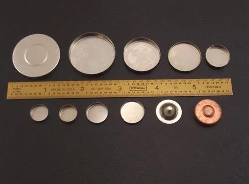 Stamped parts weld cups and contact buttons