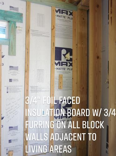 "Standard Spec 3/4 foil faced insulation board with ""34 furring on all block walls adjacent to living areas"
