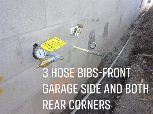 Standard Spec: 3 hose bibs-front garage wall common to house next to water heater