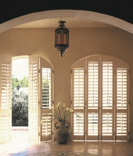 Specialty Shutters:  Custom shades templated and made to exact specs.