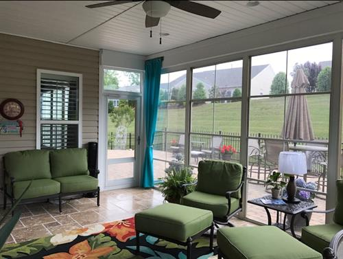 Existing patio enclosed with our white framed windows