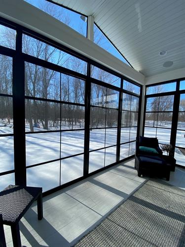 The 4Track window system installed in a sunroom application using our beautiful black frame color