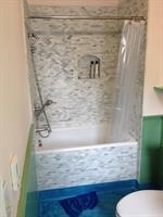 Bathroom remodel:  uncultured marble installation.