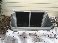 Window installation with well