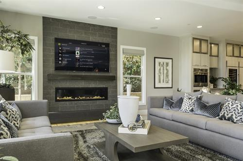 Living Room w/ TV Above Fireplace and Control4 Automation