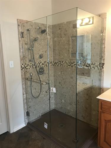 Santamargherita Marble shower wall with an Onyx shower pan and frameless glass
