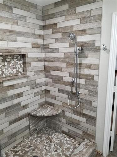 Custom porcelain plank tiled shower