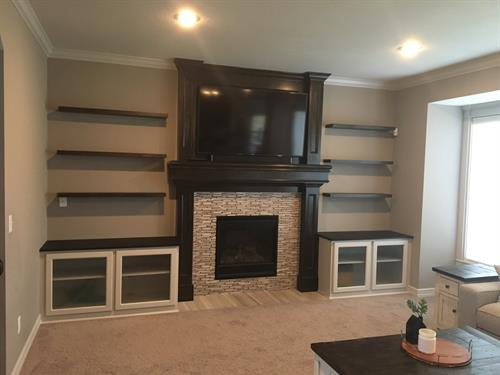 Custom floating shelves and built-in cabinets