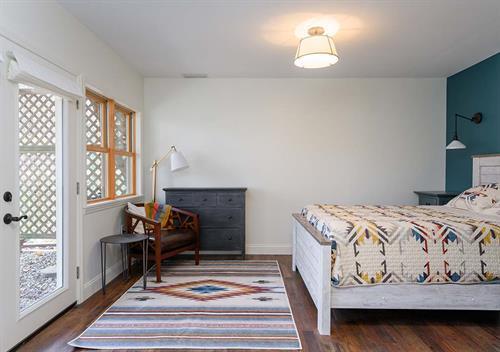 Modern and Breezy Basement Guest Room