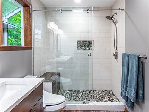 River Stone Shower Floor Bathroom Remodel