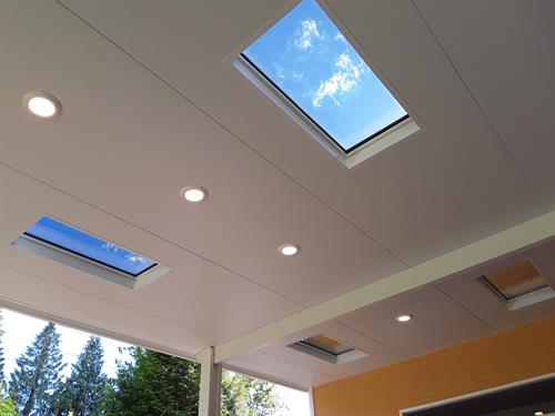 Insulated Roof Panel Patio Cover System with skylights and recessed lighting