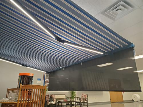 Retractable Powered Awnings with lighting and drop shade options