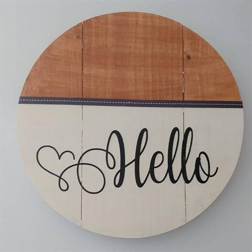 Wooden round hello sign in paint & stain with ribbon