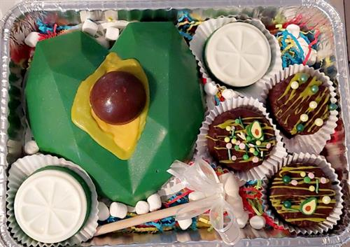 Brakable heart with surprise treats inside themed Avocado with lemon gourmet oreos covered in chocolate