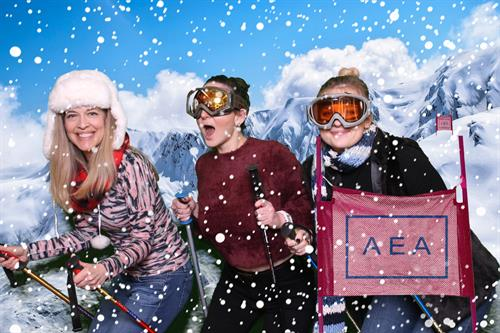 Green screen technology transports guests to a ski racing course with branded flags