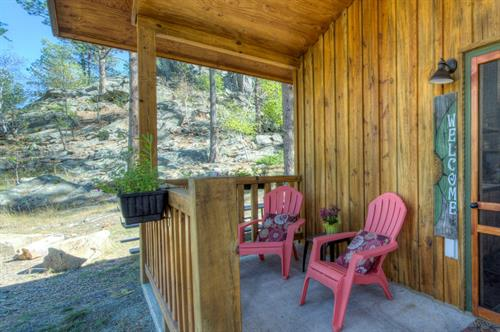Enjoy a cup of coffee, or a cold beverage on your covered porch which also includes a propane grill. Each cabin also has a picnic or patio for outdoor dining.