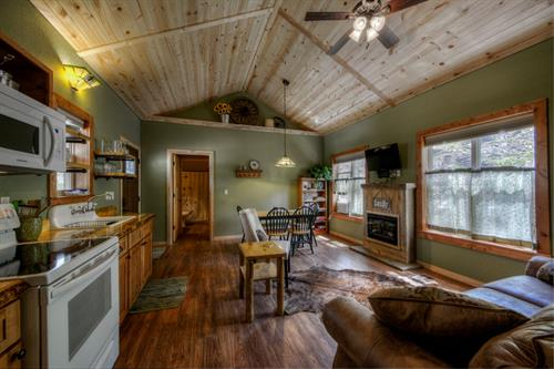 Cabin #4, custom built in 2018 sleeps up to 6 â?? two suites, one on each side of the great room. Suite 1 includes a queen bed and a full bath (tub/shower) and Suite 2 includes a queen bed and 3/4 bath (shower). The great room includes a queen sofa sleeper and a fireplace (electric).