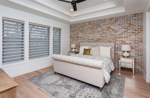 Master Bedroom with Brick Accent Wall