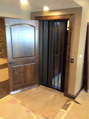 Residential Elevator - Hoistway Door Open showing closed accordion gate