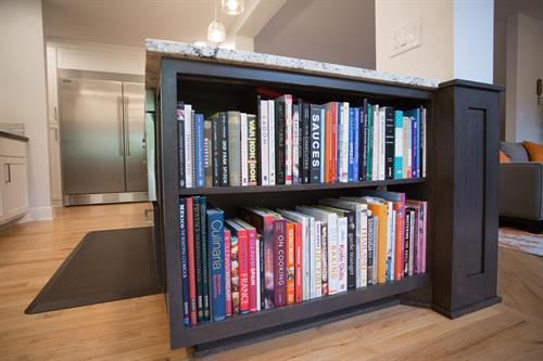 """The details, like this island's built-in cookbook storage shelves, are what make this a """"dream kitchen."""""""