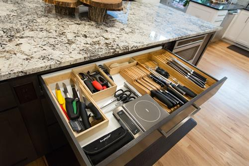 All of our drawers are soft-close and can handle 75 pounds of pressure.
