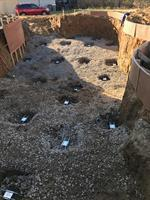 Pool being built in poor soil to be stabilized by helical piles
