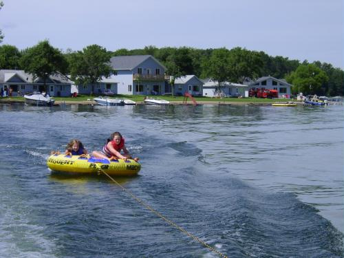 Tubing in front of our beautiful lakeside cabins...