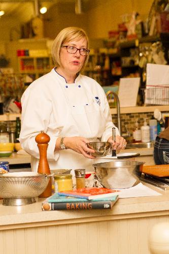 Susan Holding teaching a Cooking Class