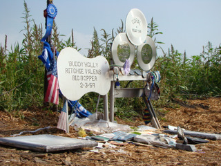 The stainless steel guitar and set of 3 records mark the exact spot where the plane came to rest.