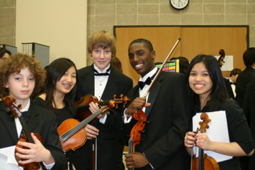 MYA orchestra students backstage at Northwestern University