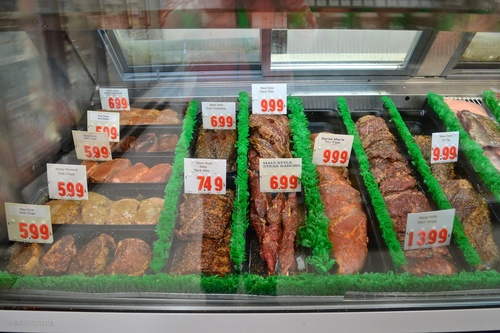 Fresh meats and a variety of marinated choices ready for the barbeque