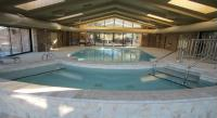 A completely refinished 2,500 square foot heated indoor swimming pool and  a 15 person whirlpool with expanded sun decks