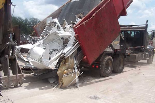 Gallery Image 1495635-Recycling-Construction-Materials---loading-the-bailer.jpg