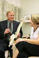Daniel Coy, M.D., Partners in Care Pain Management Physician, talks with a patient in the Pain Center.