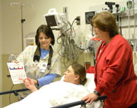 Providence Emergency Services Nurses educate a patient on pain levels.