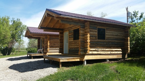 Two cozy cabins available, sleep 4, frig, microwave, table/chairs