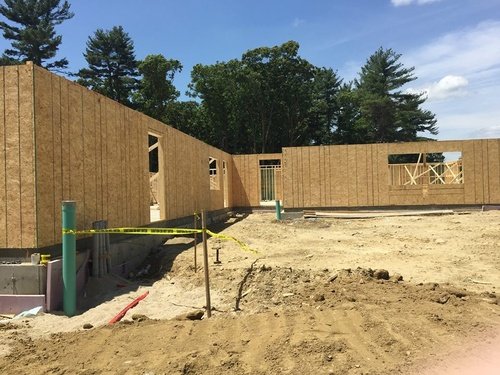 Check out all the construction progress - The walls have gone up and the roof is coming later this week!