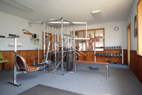 weight training room in indoor pool complex