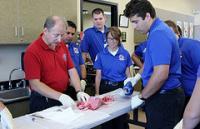 HCC EMT Professor Linder demonstrates a procedure