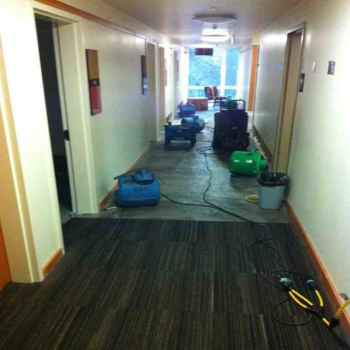 SERVPRO of Tigard/Tualatin working at a hotel that had a pipe break and water run down and cause damage on several floors.