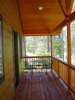 Family Cabins have private balconies with a mountain view.